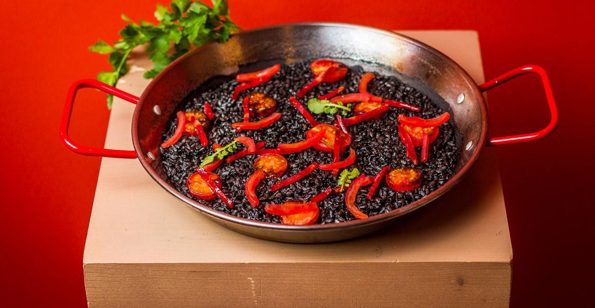 Spanish black rice with chorizo and Azura cherry tomatoes
